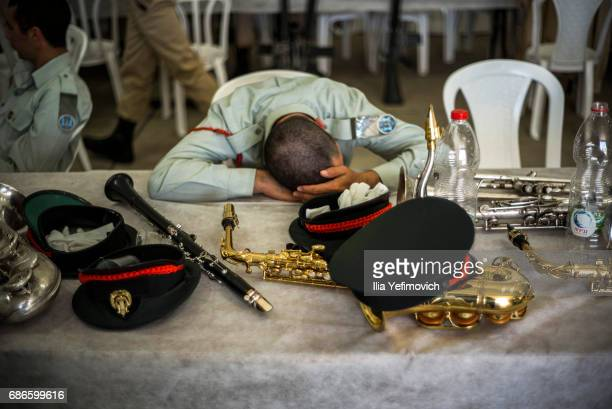 An Israeli soldier rests during preparations ahead of President Trump's landing on May 22 2017 in Tel Aviv Israel This will be Trump's first visit as...
