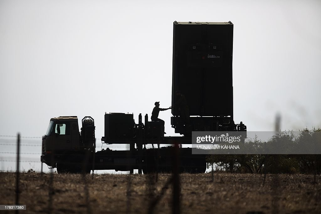 An Israeli soldier sits next to an anti-missile radar positioned in the North of Israel on August 29, 2013. The Israeli cabinet authorised on August 28 a partial call-up of army reservists amid growing expectations of a foreign military strike on neighbouring Syria, army radio reported. The unspecified number of troops are attached to units stationed in the north of the country, which borders both Lebanon and the Golan Heights.