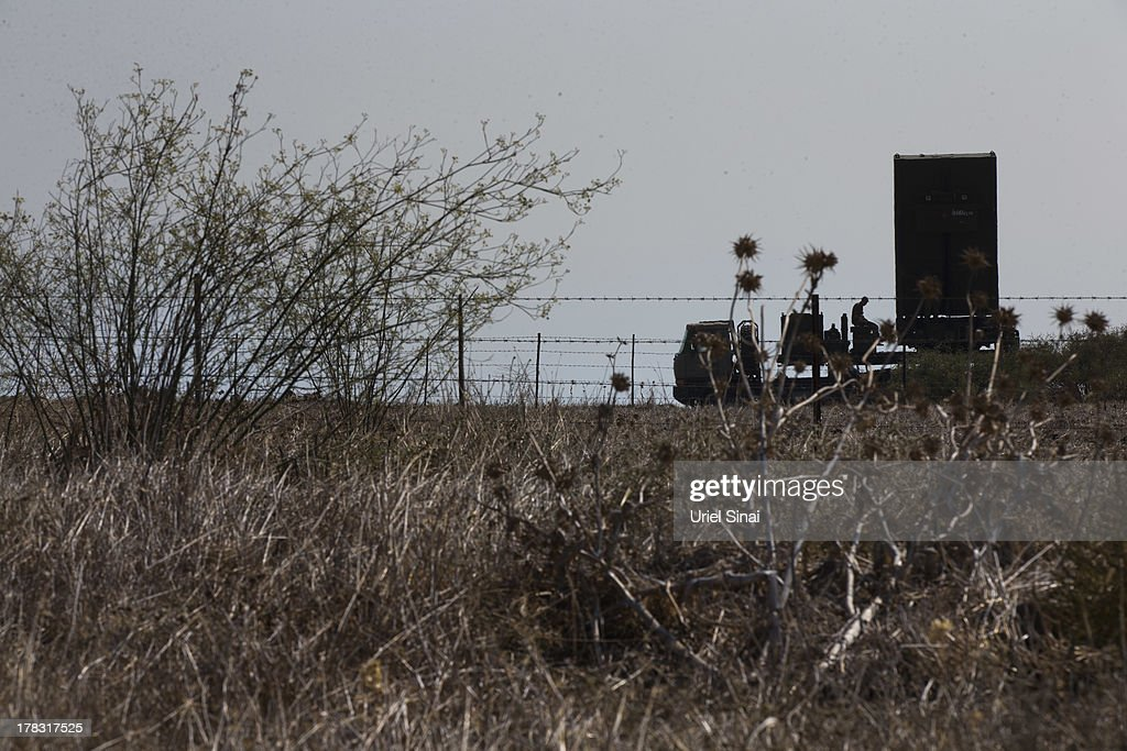 An Israeli soldier sits on a radar which is part of the 'Iron Dome' short-range missile defense system on August 29, 2013 in Northern Israel. Tensions are rising in Israel amid international talks of a military intervention In Syria.
