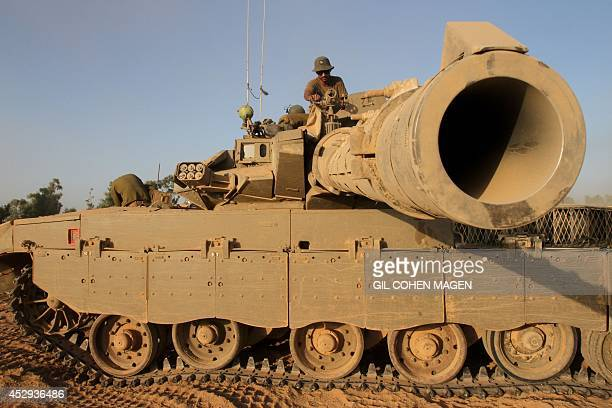 An Israeli soldier sits on top of a Merkava tank along the border between Israel and the Hamascontrolled Gaza Strip on July 30 after returning from...