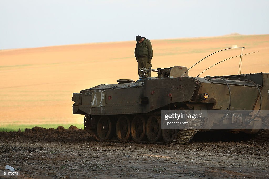 An Israeli soldier stands on his Armored Personnel Carrier along the IsraeliGaza border January 5 2009 in Israel Heavy fighting continues between...