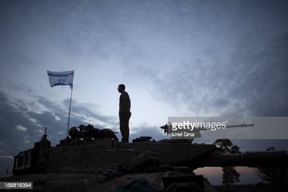 An Israeli soldier stands on his tank in a deployment area on November 22 2012 on Israel's border with the Gaza StripThe ceasefire between Israel and...