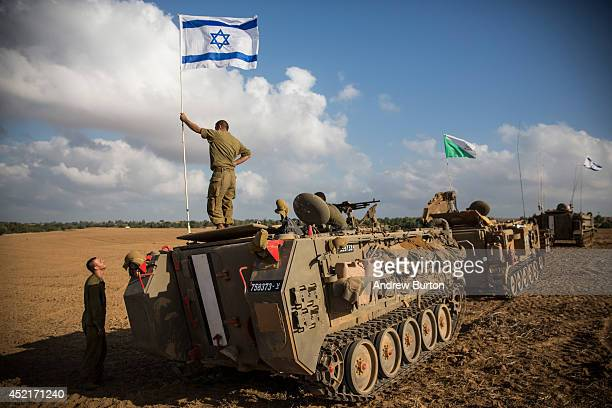 An Israeli soldier stands on top of an armored personnel carrier near the IsraeliGaza border on July 15 2014 near Sderot Israel As operation...