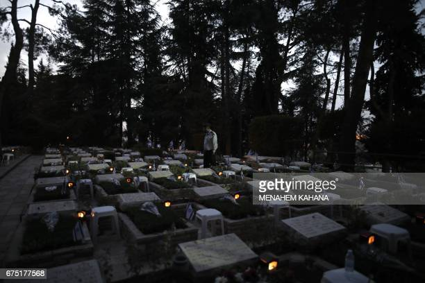 An Israeli soldier visits the Mount Herzel military cemetery in Jerusalem on April 30 at the start of Remembrance Day commemorating fallen soldiers...