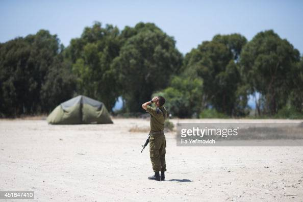 An Israeli soldier watches helicopters on July 8 in Ashkelon Israel Due to recent escalation in the region the Israeli army started new deployments...