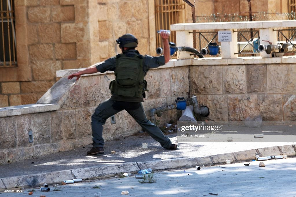 An Israeli soldiers gets ready to throw a stun grenade into a group of Palestinian protesters below him. The Islamic Jihad faction organized protests in solidarity with Gaza, in the West Bank city of Bethlehem. As ceasefire talks collapsed completely in Cairo earlier this week, and fighting renewed on Wednesday. Hamas launched a barrage of rockets towards Southern Israel, some reaching as far as Jerusalem and illegal Israeli settlements in the West Bank, some 80 kilometers away from Gaza. Late Tuesday evening an Israeli missile struck the home of Hamas military commander Muhammad Deif, killing his wife and three-year-old daughter. Deif, according to Hamas reports was not assassinated. On Thursday, three more to military commanders, Muhammad Abu Shammala, Raed al-Attar and Muhammad Barhoum were also killed in airstrikes. In response, Hamas killed what they believed to be collaborators with Israel in Gaza. 18 suspected of having worked with Israeli army intelligence have been killed so far. Late Friday afternoon, a four-year-old Israeli child from Nihal Oz was killed by mortar fire from Gaza. To date, the death toll from the Gaza war stands at 2090 Palestinians and 67 Israelis.