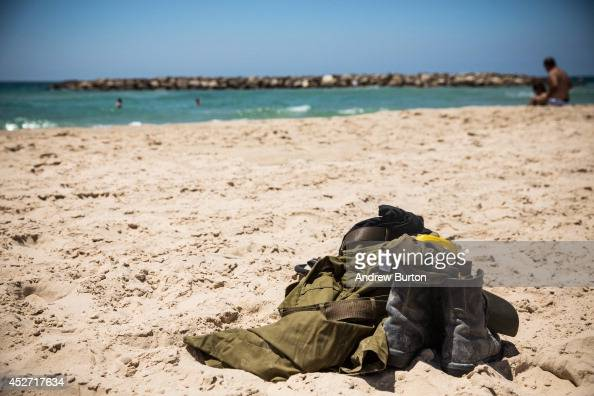 An Israeli soldier's uniform and boots sit in the sand on the beach during a 12hour ceasefire just outside the militarized zone near the IsraeliGaza...