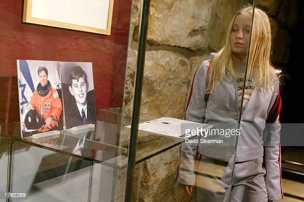 An Israeli student pauses at an exhibit honoring the memory of Israeli astronaut Ilan Ramon and 14yearold Jewish boy Petr February 5 2003 at the Yad...