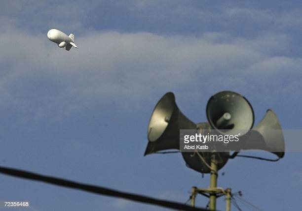 An Israeli surveillance balloon floats over loudspeakers of Azam mosque November 2 2006 in Beit Hanoun in the northern Gaza Strip According to...