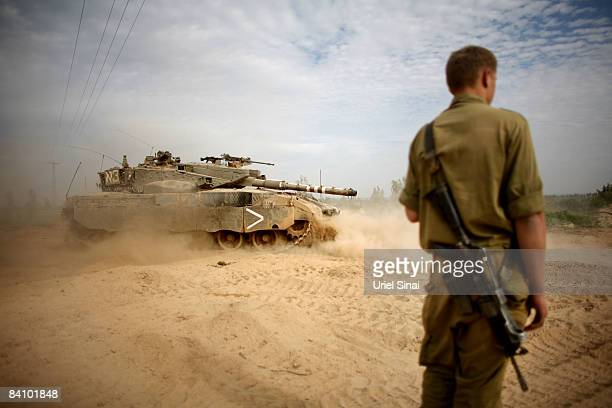 An Israeli tank maneuvers during a deployment near the Israeli border with Gaza on December 21 2008 near kibbutz Kisufim Israel A sixmonth ceasefire...