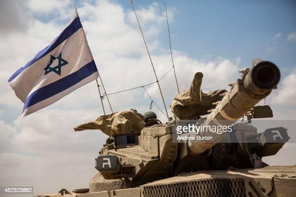 An Israeli tank moves positions near the IsraeliGaza border on the morning of July 18 2014 near Sderot Israel Late last night the Israel operation...