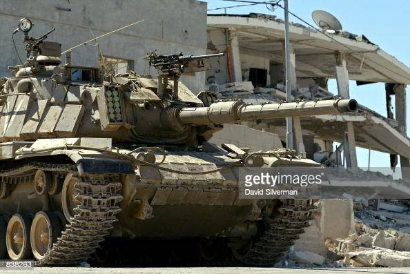 An Israeli tank stands guard outside Palestinian leader Yasser Arafat's compound June 24 2002 in the West Bank city of Ramallah Israeli troops...