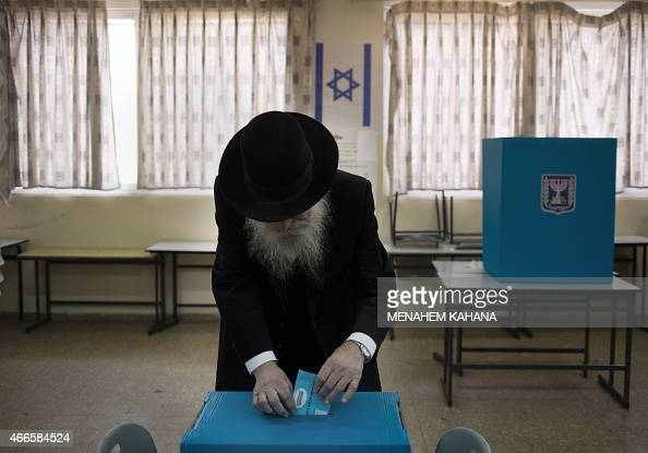 An Israeli ultraorthodox Jewish man casts his ballot at a polling station in Jerusalem on March 17 2015 Israelis are voting in a closefought election...