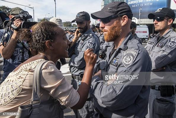 An Israeli woman from the Ethiopian community argues with Israeli security forces in the coastal city of Tel Aviv on May 03 during a protest called...