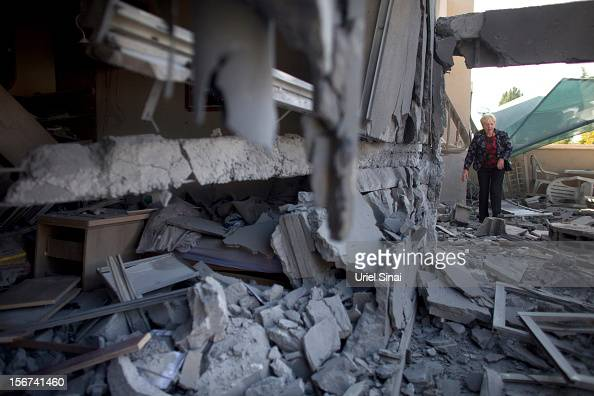 An Israeli woman inspects her house after it was hit by a rocket fired from the Gaza Strip on November 20 2012 in Beersheba Israel Hamas militants...