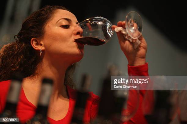 An Israeli woman tastes a red wine at the threeday 2nd International Wines Exhibition which opened February 26 2008 in Tel Aviv The fair is a...