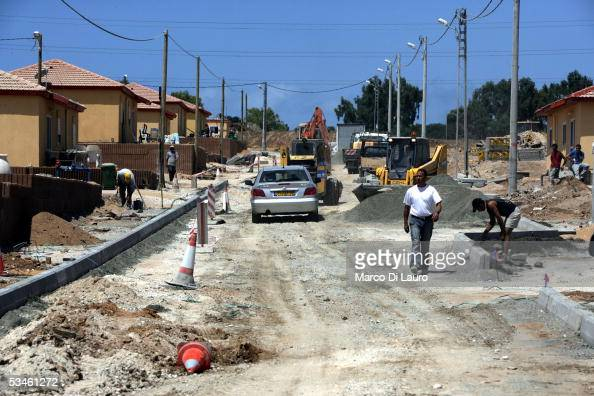 An Israeli worker walks down the street August 25 2005 in the under construction temporary city of Nitsan between Ashkelon and Ashdod in Israel The...