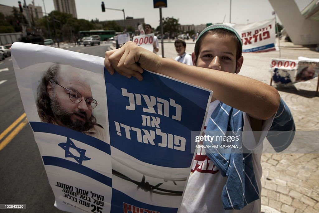 An Israeli youth demonstrator holds a picture of Jonathan Pollard, a Jewish American who was jailed for life in 1987 on charges of spying on the United States, during a demonstration for his release in Jerusalem on July 13, 2010. Pollard is a convicted Israeli spy and a former United States Naval civilian intelligence analyst who received a life sentence in the mid 1980s.