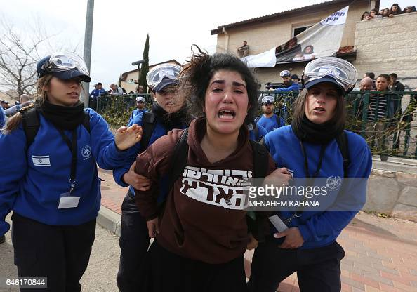 An Israeli youth supporter of settlements cries as Israeli police forces move protestors away from a house which is due to be emptied and demolished...