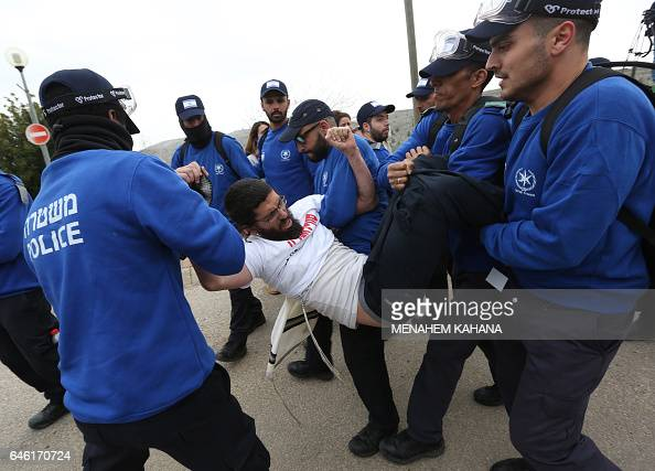 An Israeli youth supporter of settlements is carried away by Israeli police forces in the settlement of Ofra in the occupied West Bank during an...
