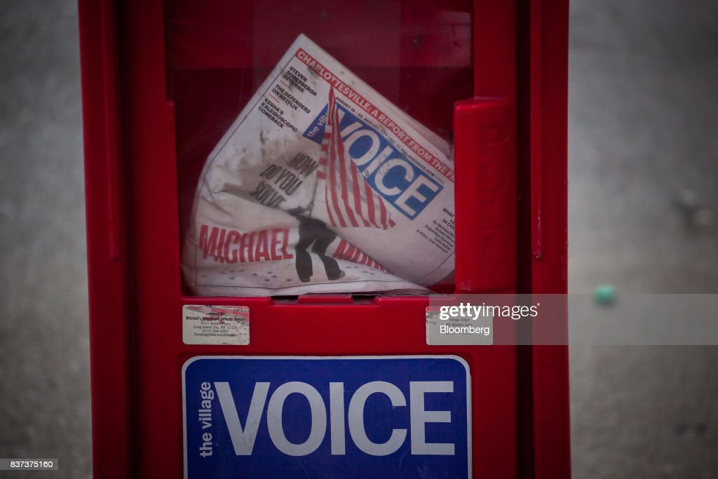 An issue of The Village Voice is seen inside a distribution box in the East Village neighborhood of New York, U.S., on Tuesday, Aug. 22, 2017. Peter Barbey, owner of The Village Voice since 2015, has decided to no longer produce a print edition of the alt-weekly publication. The company's announcement, made Tuesday afternoon, came as a surprise, a shock and a disappointment to the larger media industry on Twitter. Photographer: Michael Nagle/Bloomberg via Getty Images