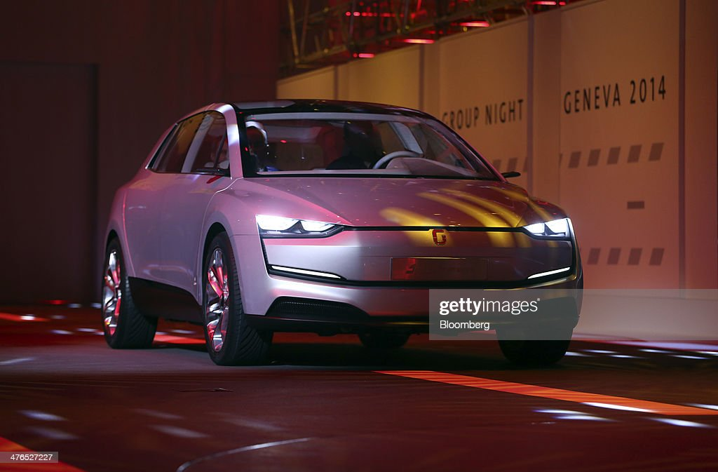 An Italdesign Clipper concept electric automobile, produced Italdesign Giugiaro SpA, is driven on to the stage during its unveiling ahead of the opening day of the 84th Geneva International Motor Show in Geneva, Switzerland, on Monday, March 3, 2014. The International Geneva Motor Show will run from Mar. 4, and showcase the latest models from the world's top automakers. Photographer: Chris Ratcliffe/Bloomberg via Getty Images