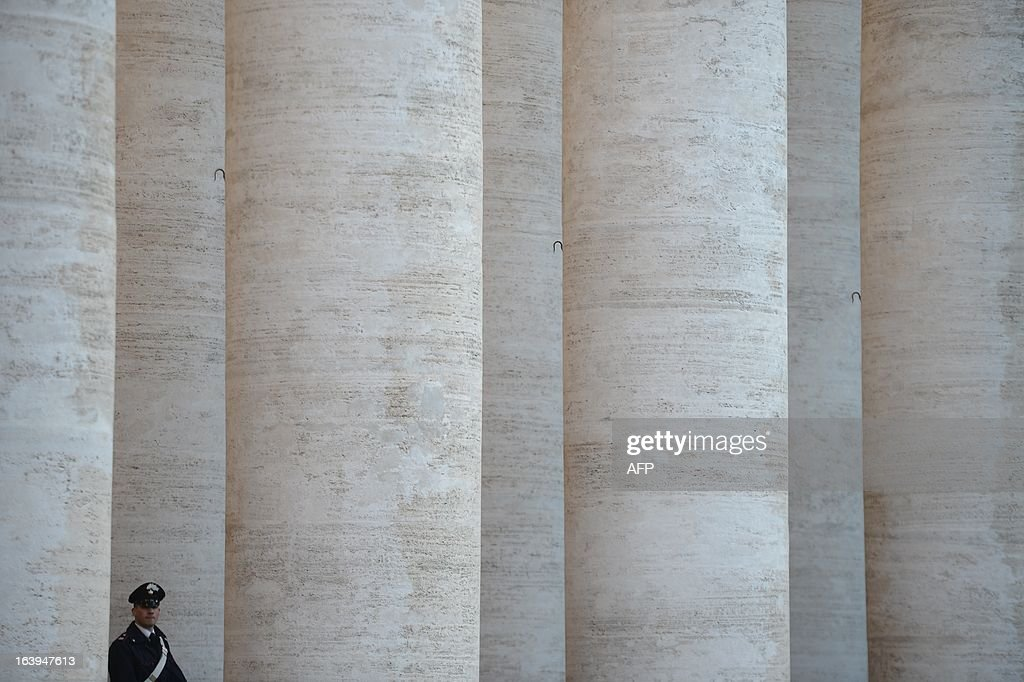An Italian carabinieri policeman stands under the colonnade at St Peter's square on March 18, 2013 at the Vatican, on the eve of Pope Francis inauguration mass. The leader of the world's 1.2 billion Catholics will be formally enthroned tomorrow at a mass in St Peter's Square, with city authorities preparing for an influx of up to a million people to Rome.