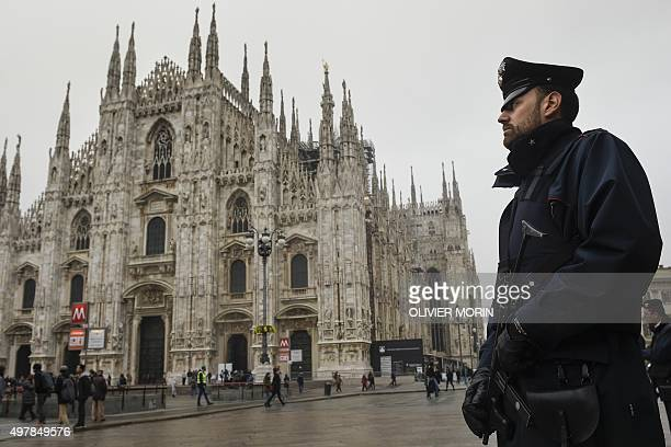 An italian carabinieri stands at Piazza del Duomo on November 19 2015 in Milan Italy has increased security at its historic monuments in the Vatican...