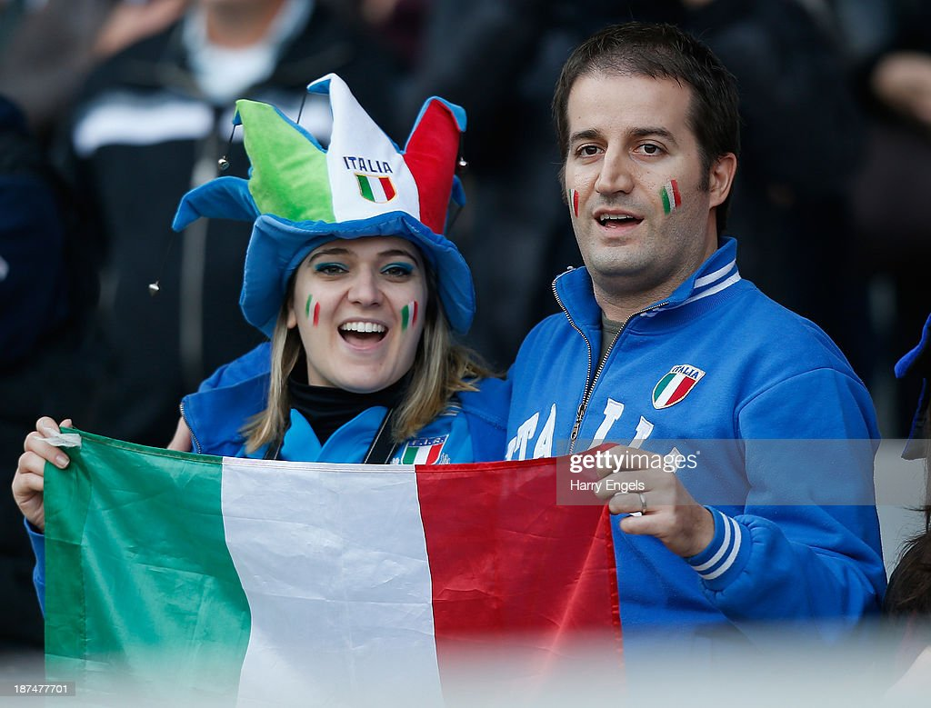 An Italian couple sing their national anthem prior to the international match between Italy and Australia at the Stadio Olimpico on November 9, 2013 in Turin, Italy.