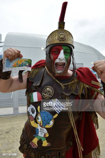 An Italian fan poses outside the Dunas Arena prior to a Group D football match between Italy and Uruguay in Natal during the 2014 FIFA World Cup on...