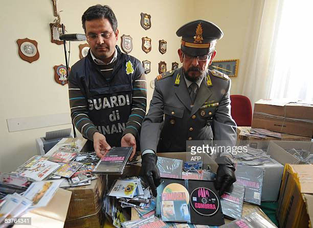An Italian financial policemen hold up an illegal copies of the film Gomorra on DVD an adaptation of the book Gomorra by Italian writer Roberto...