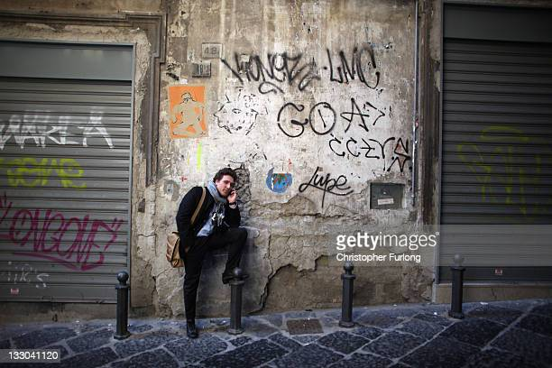 An Italian man talks on his phone in an alleyway of central Naples on November 16 2011 in Naples Italy Italian Prime Minster designate Mario Monti...