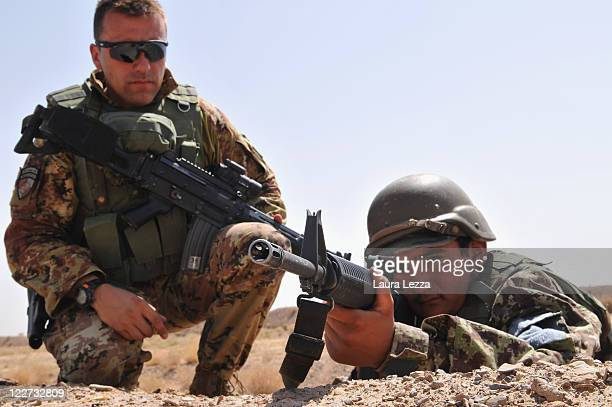 An Italian military advisor of the NTMA oversees a student of the Afghan security forces belonging to the NCOBC during training on August 27 2011 in...