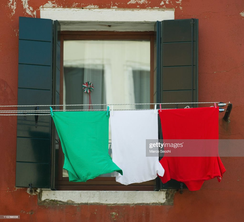 An Italian National Flag composed by three T Shirts hangs outside a window on the day of the celebrations for the 150th anniversary of Italy's unification on March 17, 2011 in Venice, Italy. Events in various Italian cities will celebrate the 150th anniversary of Italy's unification until the end of the year. National Festivity begins on March 17.