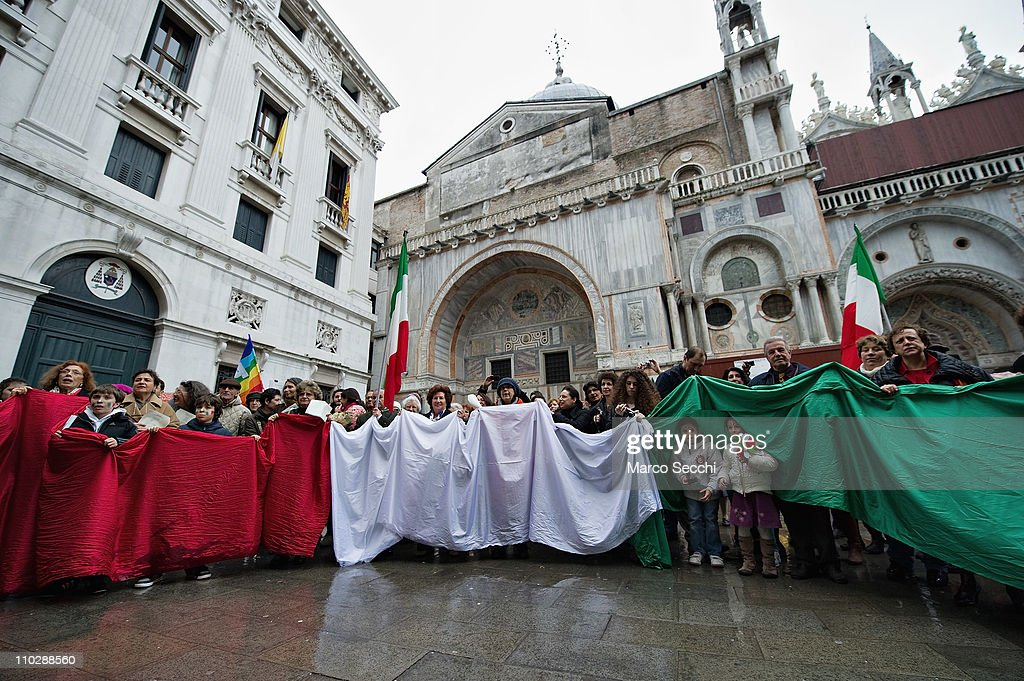 An Italian national flag is displayed in St Mark Square on the day of the celebrations for the 150th anniversary of Italy's unification on March 17, 2011 in Venice, Italy. Events in various Italian cities will celebrate the 150th anniversary of Italy's unification until the end of the year. National Festivity begins on March 17.