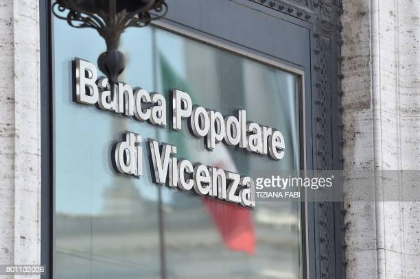 An Italian national flag reflects on the window of the Banca Popolare di Vicenza branch at Piazza Venezia in central Rome on June 26 2017 Up to 3900...