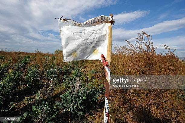 An Italian National Ranger sign marks an area filled with waste on the sides of an agriculture field near Orta di Atella southern Italy on November...