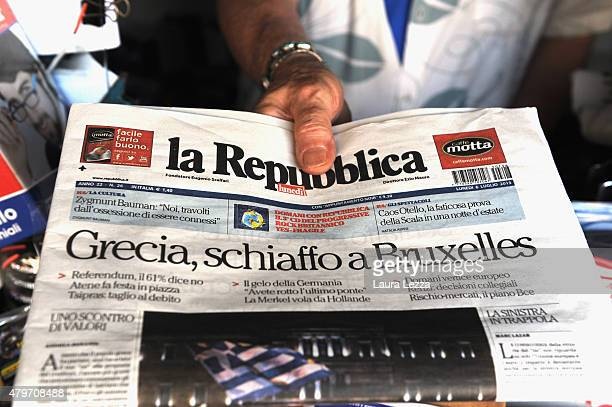 An Italian newsagent sells one of the major Italian newspapers which has run with the headline 'Greece Slap Brussels' the day after Greece's...