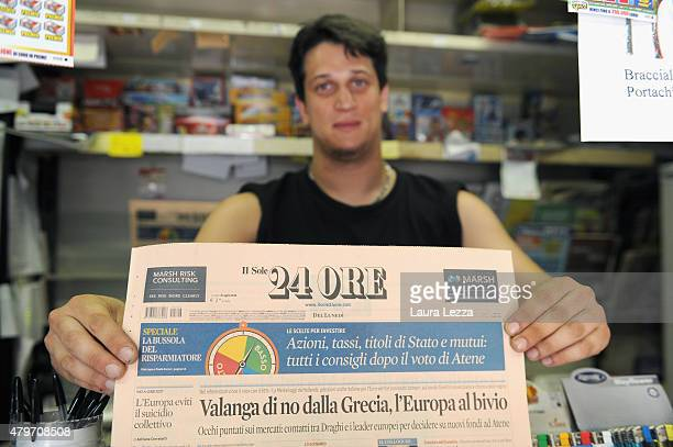 An Italian newsagent shows a major Italian economic newspaper whose title reads 'Avalanche of no from Greece Europe at a crossroads' the day after...