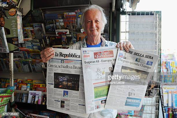 An Italian newsagent shows the major Italian newspapers the day after Greece's austerity referendum which dominates the Italian front pages today on...
