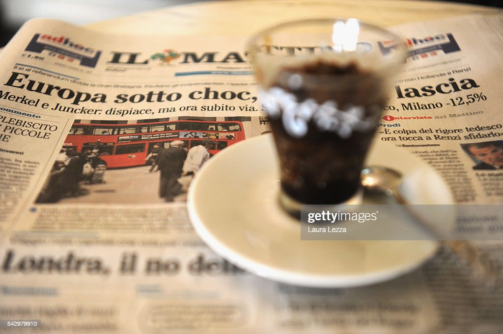 An Italian newspaper declaring about Brexit and UK leaving the European Union is displayed inside a bar with ice coffee on June 25, 2016 in the town of Nola near Naples, Italy. The results from the historic EU referendum has been declared and the United Kingdom has voted to leave the European Union.