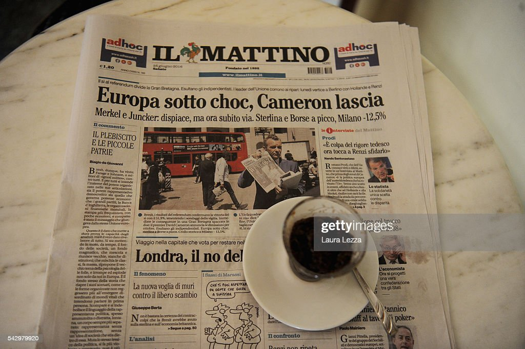 An Italian newspaper declaring about Brexit and UK leaving the European Union is displayed inside a bar with ice cffee on June 25, 2016 in the town of Nola near Naples, Italy. The results from the historic EU referendum has been declared and the United Kingdom has voted to leave the European Union.
