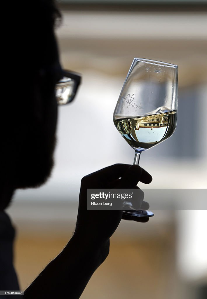 An Italian oenologist tests a glass of Prosecco wine for authenticity at a restaurant in Treviso, Italy, on Tuesday, Sept. 3, 2013. Italy's Agriculture Ministry has begun to investigate suspected sales of imitation Prosecco sparkling wine in its native Veneto region. Photographer: Alessia Pierdomenico/Bloomberg via Getty Images