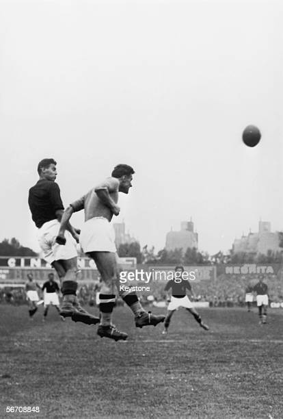 An Italian player heads the ball during the final of the 1938 World Cup between Italy and Hungary at the Stade Colombes in Paris 19th June 1938