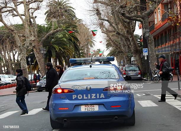 An Italian police car patrols in the streets of Ventimiglia in northwestern Italy near the French border on February 21 2012 The town's municipal...