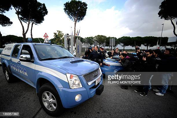 An Italian police officer leaves the Equitalia parking a public company responsible for collecting taxes in Italy after a letter bomb exploded on...