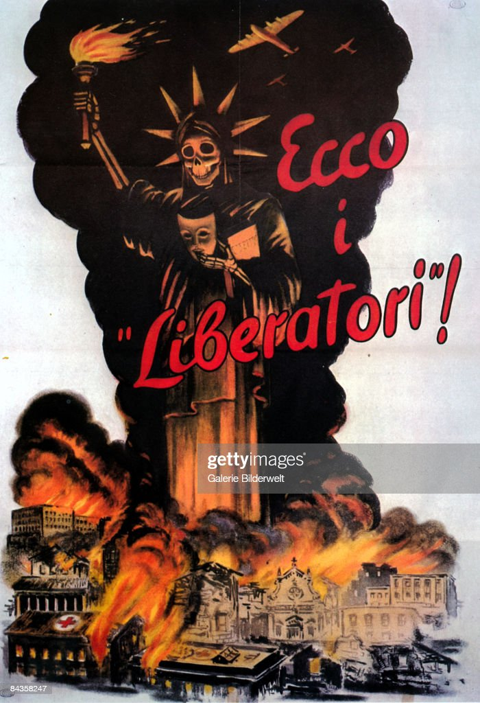 An Italian poster from World War II depicts the Statue of Liberty removing her mask to reveal a grinning skull, as she presides over the destruction, 1944. The caption reads 'Ecco i liberatori!' ('Here are the liberators!').