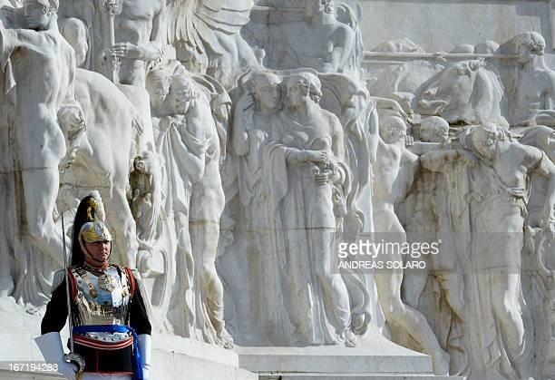 An Italian presidential guard stands at attention on April 22 2013 before the arrival of Italian President Giorgio Napolitano at the Altare della...