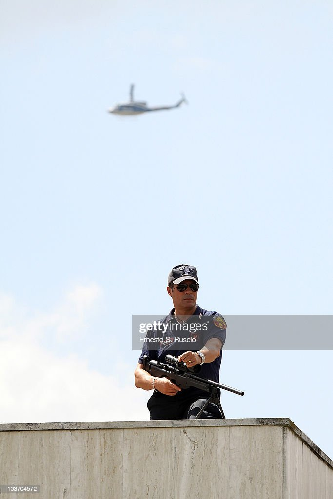 An Italian Security Service sniper keeps watch during Libyan leader Muammar Gaddafi arrival at the Ciampino airport on August 29, 2010 in Rome, Italy. Gadaffi is on an official two-day visit to Italy for talks with Prime Minister Silvio Berlusconi. The visit also marks the second anniversary of a friendship treaty between Italy and Lybia.