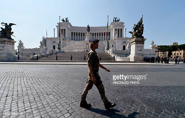 An Italian soldier marches in front of the Altare della Patria during a military parade in Rome on June 2 2012 to mark the anniversary of the...
